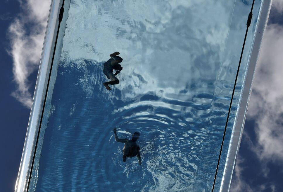 Residents relax in the Embassy Gardens Sky Pool in London