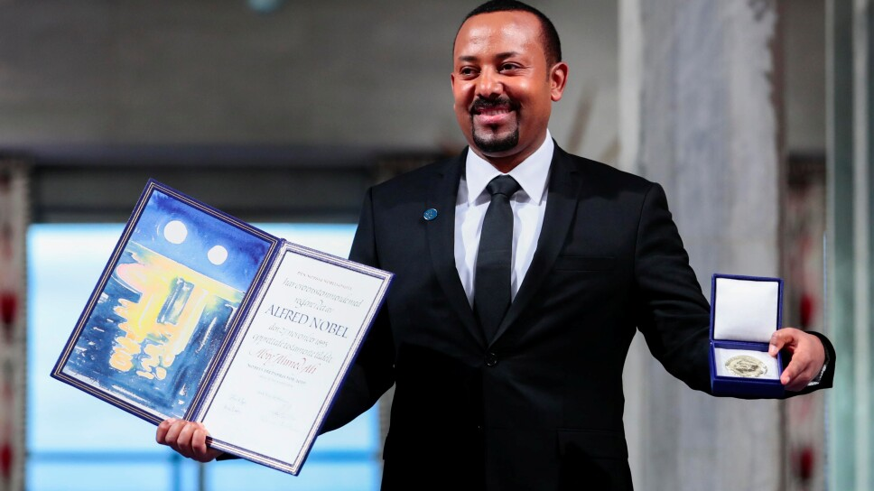 Ethiopian Prime Minister Abiy Ahmed Ali poses with medal and diploma after receiving Nobel Peace Prize during ceremony in Oslo City Hall