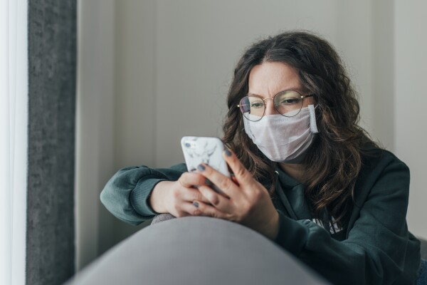 Worried Woman is Reading News on Phone