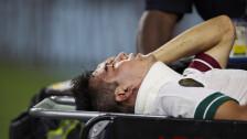 Hirving Lozano sale en camilla en la Copa Oro