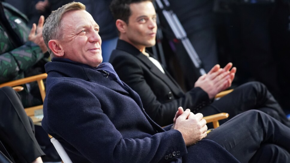 "Actors Daniel Craig and Rami Malek react during a promotional appearance on TV in Times Square for the new James Bond movie ""No Time to Die"" in the Manhattan borough of New York City"
