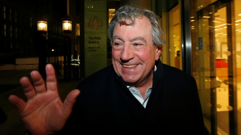 FILE PHOTO: British comedian Jones smiles as he leaves The Rolls Building in central London