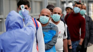 Palestinian worker return from Israel amid concerns about the spread of the coronavirus disease, in the Israeli-occupied West Bank