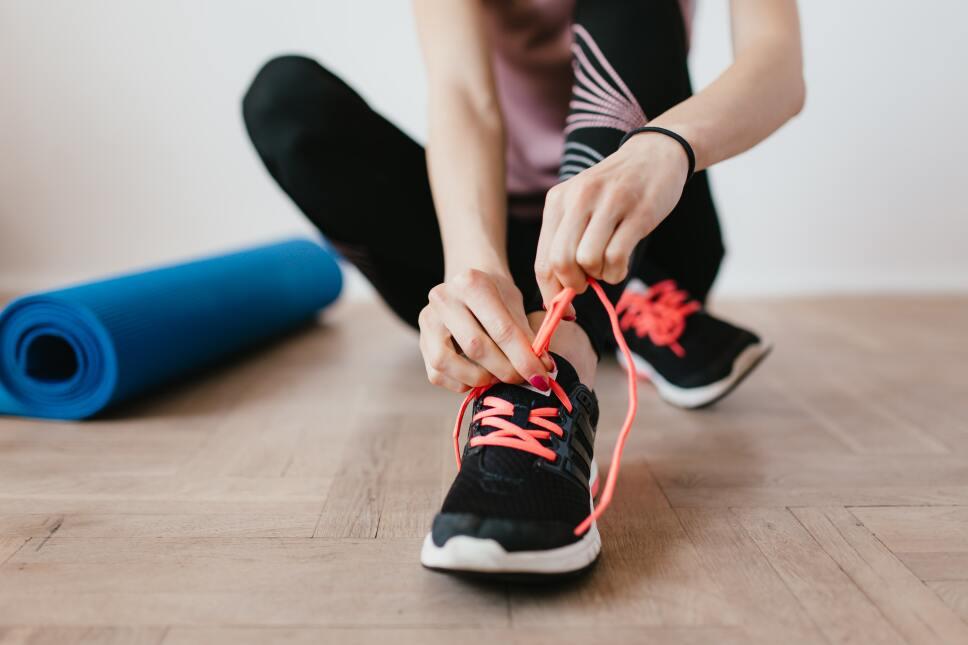 crop-young-sportswoman-tying-shoelaces-on-sneakers-4498555.jpg