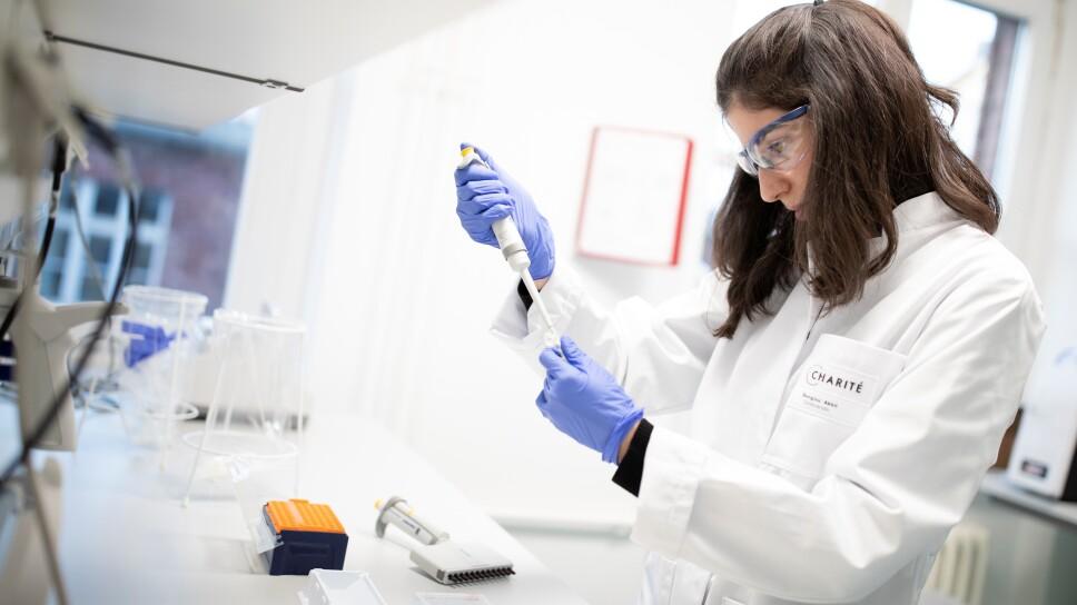Charite hospital employees prepare a test for new coronavirus in Berlin