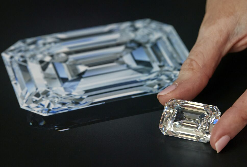 A staff holds a rectangular step-cut diamond of 100.94 carats  during a preview at Christie's in Geneva