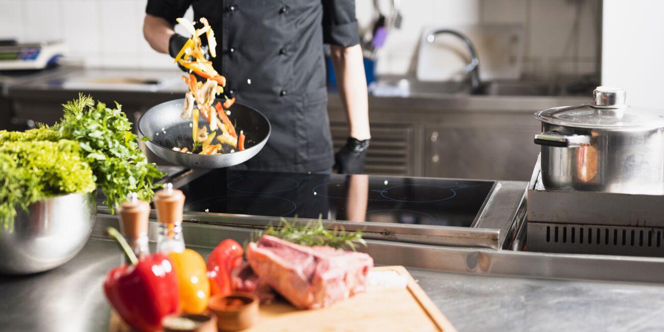 cook-tossing-vegetables-frying-pan.jpg