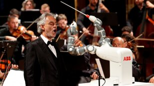 Humanoid robot YuMi conducts the Lucca Philharmonic Orchestra performing a concert alongside Italian tenor Andrea Bocelli at the Verdi Theatre in Pisa