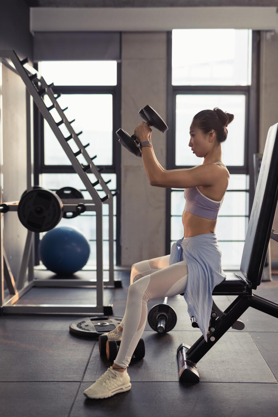photo-of-woman-sitting-and-raising-dumbbells-2475875.jpg