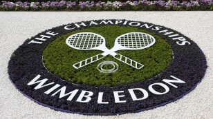 FILE PHOTO: A Wimbledon logo is seen inside the grounds at the Wimbledon tennis championships in London