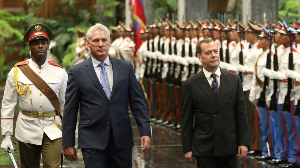 Cuba's President Miguel Diaz-Canel and Russia's Prime Minister Dmitry Medvedev review an honour guard during a ceremony at the Revolution Palace in Havana