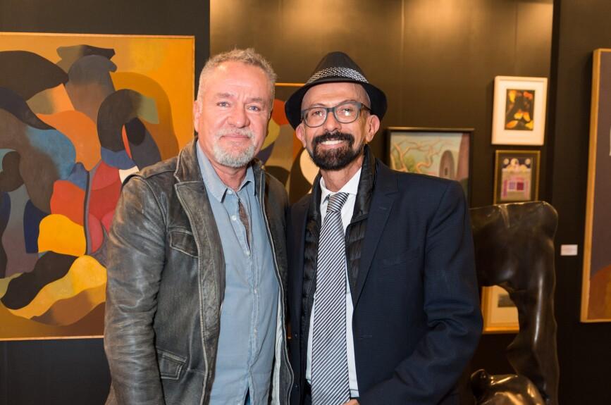 Alberto Castro y el  galerista Oscar Román