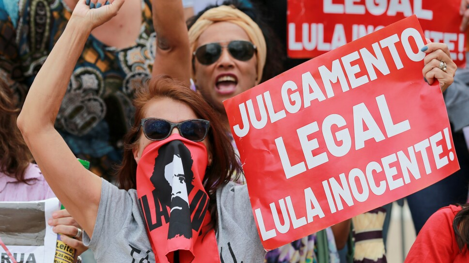 Supporters of former Brazilian President Lula da Silva gather in front of the TRF-4 appeals court in Porto Alegre