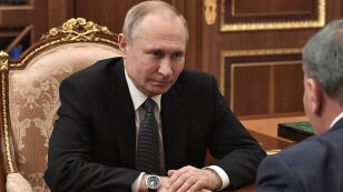 Russian President Vladimir Putin listens to Deputy Prime Minister Yury Borisov during a meeting in Moscow