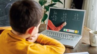 6-7 years cute child learning mathematics from computer.