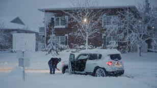 Woman shovels snow in Arlington Heights