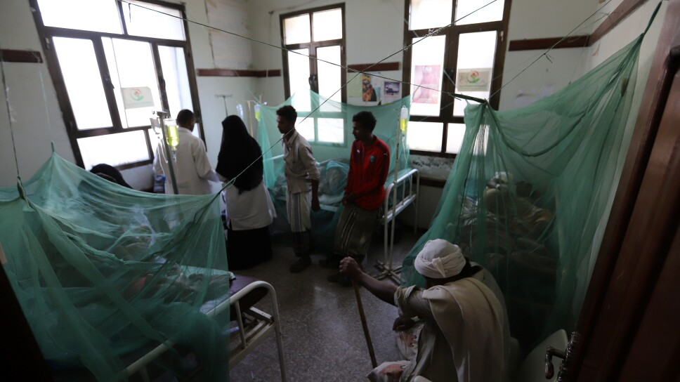 Nurses and relatives stand as patients recuperate from dengue fever at a hospital in al-Jarrahi district of Hodeidah