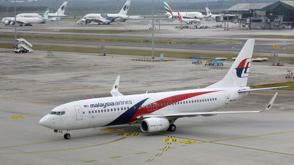FILE PHOTO: A Malaysia Airlines Boeing 737 plane arrives at Kuala Lumpur International Airport in Sepang