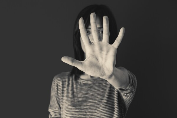 Woman making stop gesture with her hand