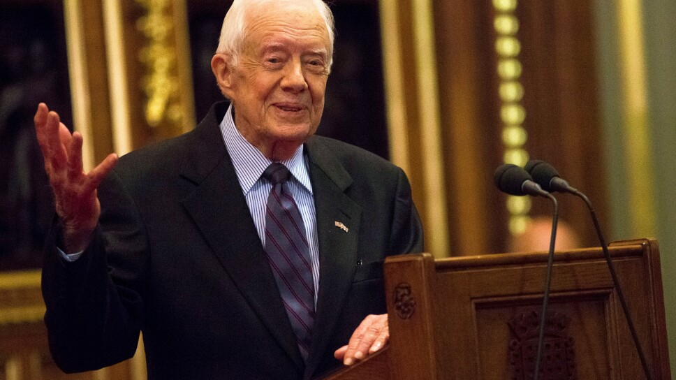 FILE PHOTO: Former U.S. President Jimmy Carter delivers a lecture on the eradication of the Guinea worm, at the House of Lords in London