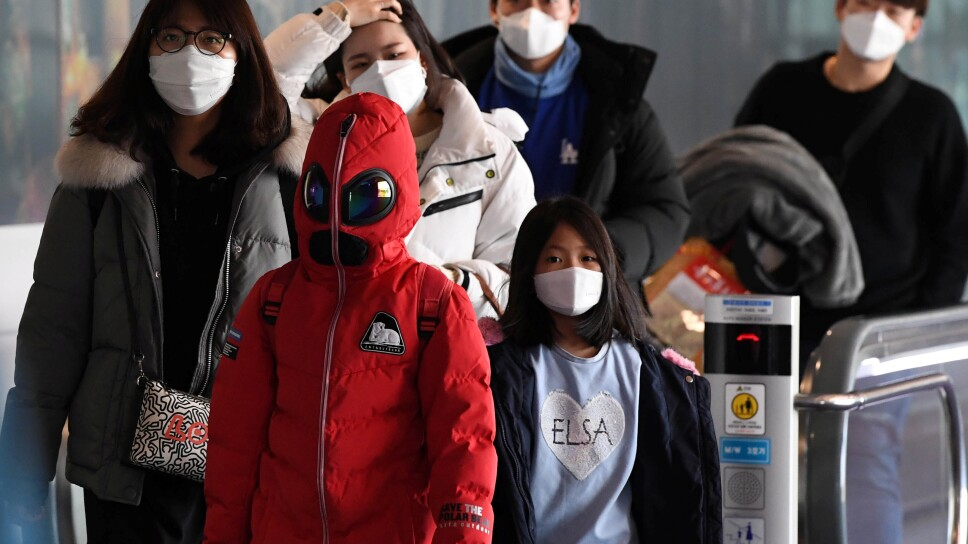Passengers wearing masks to prevent a new coronavirus arrive at Incheon International Airport in Incheon